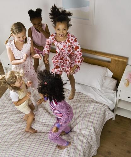 Multi-ethnic girls having slumber party